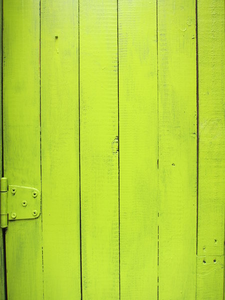 Painted Wood: Green painted wood.