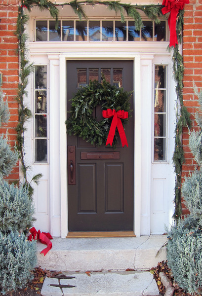 Wreath: Christmas wreath on a door.