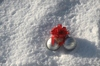 Christmas baubles in the snow