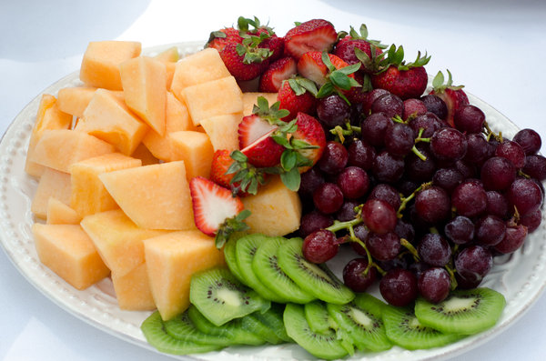 Fruit tray: Small fruit tray with kiwi, strawberries, melon and grapes