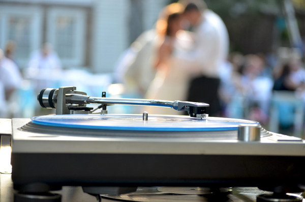 Wedding Turntable: A DJ's wedding turntable with the couple dancing in the background