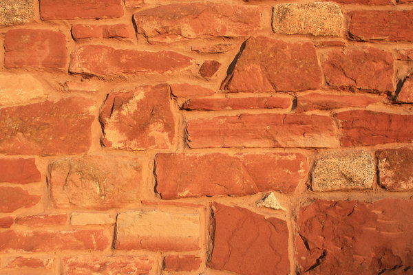 Red stone wall background: Red stone wall background