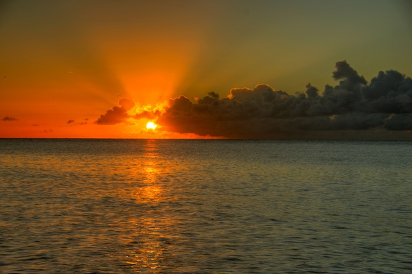 Sunrise - HDR: Sunrise above the ocean with lots of sunrays. The image is HDR,