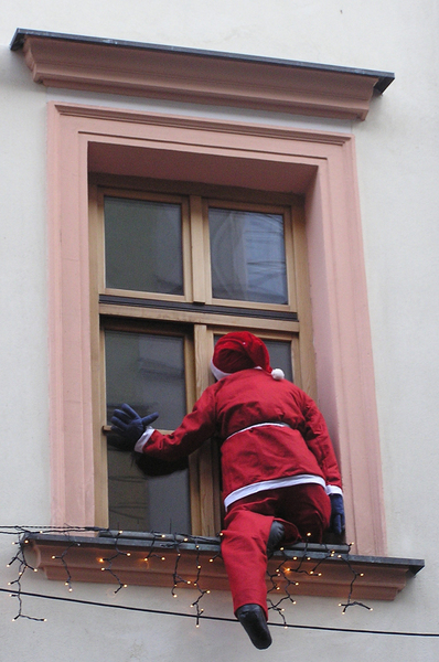 Santa Claus: Santa Claus coming through the window.