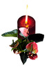 Red candle with foliage