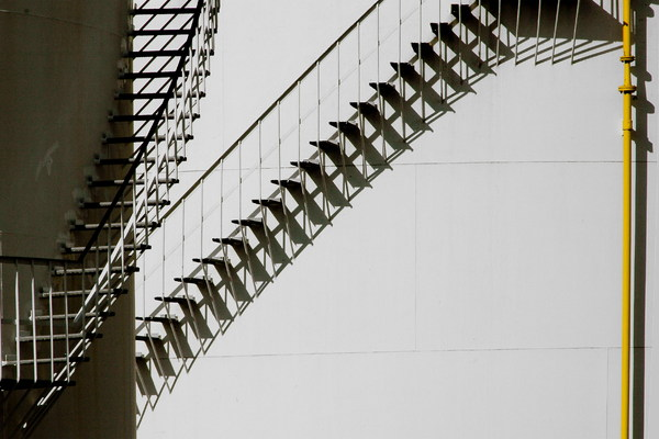 stairs with their shadow: detail of an industrial storage complex