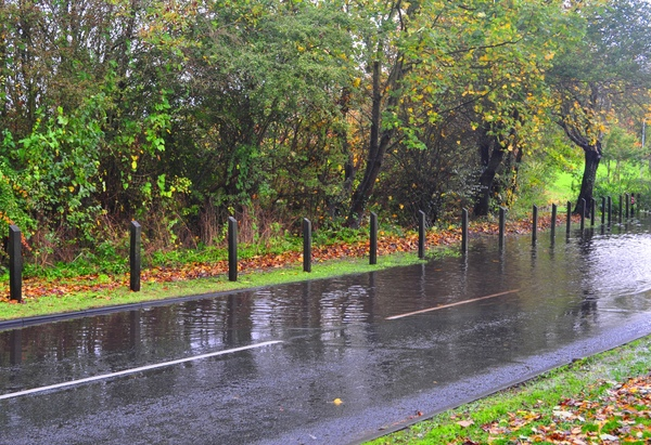 Flooded road: Flooded road in Surrey. Autumn time. Still raining lightly