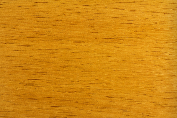 Wood Shelf Board: The wood grain texture of a varnished shelf board.