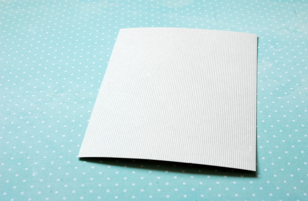something to write on: A blank sheet of paper on a dotted background.