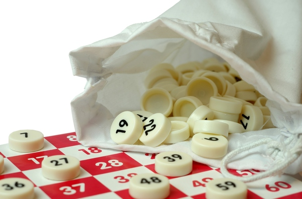Bingo: Bingo announcers board with bag and numbers