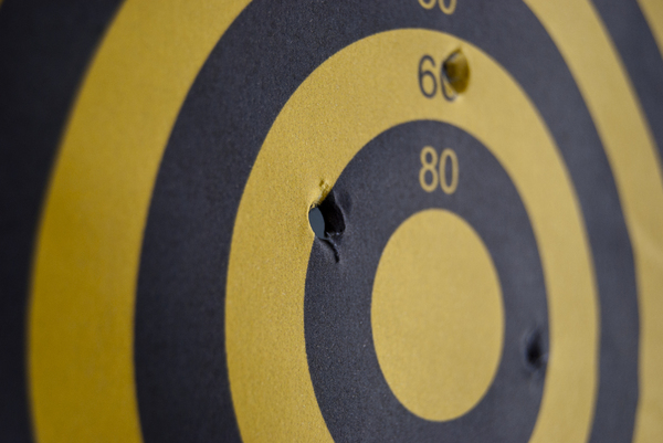 target: target with bullet hole.