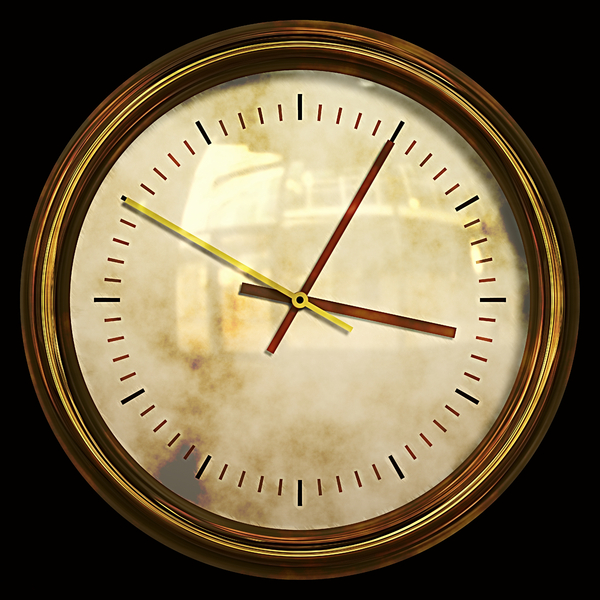 Grunge Clock: A grungy golden clock on a black background.