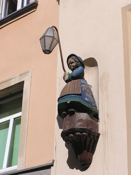 Woman lamp: A lamp in Jelenia Góra - a figurine of a woman.