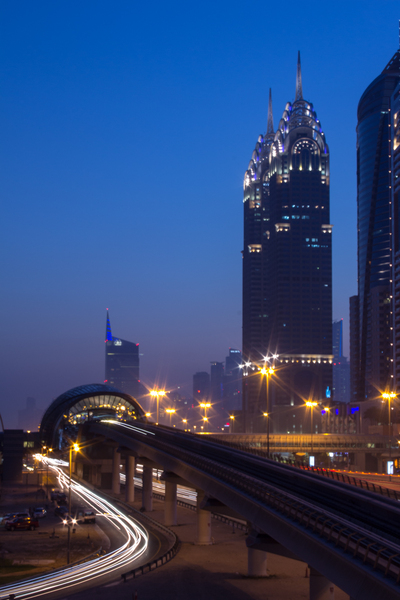 Night Scene: Dubai metro and Sheikh Zayed Road at night