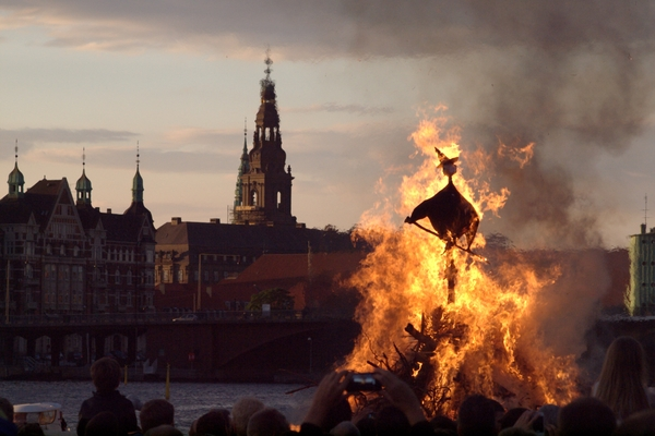 Witch burning: At midsummer we brun the witches - that is: we burn dolls looking like witches. The tower in the background is the tower of Christiansborg, Denmark. The parliament of Denmark.