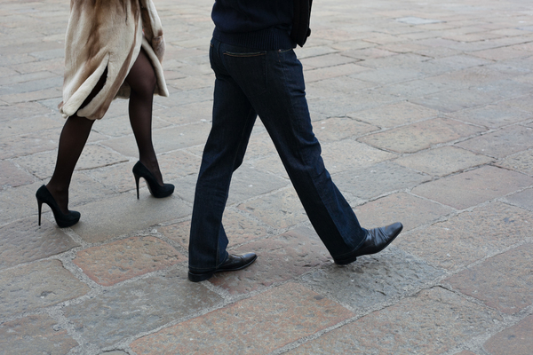 People Walking In The Streets: Photo of a couple walking in the streets