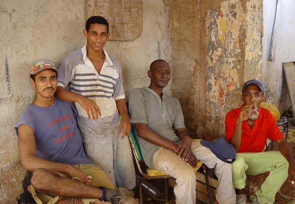 cuban people: A cuban group in a market place in Havana, Cuba