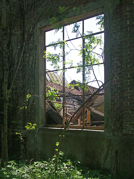 window with a view of ruined b: window of an abandoned builing with a view of an abandoned factoryLombardy, Northern Italy