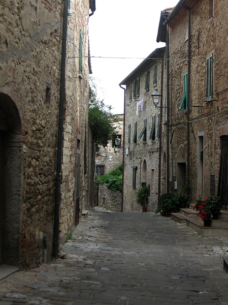 narrow street: narrow streen between old houses, Tuscany, Italy