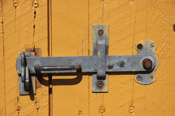 Door lock: Old door lock at a yellow wooden door