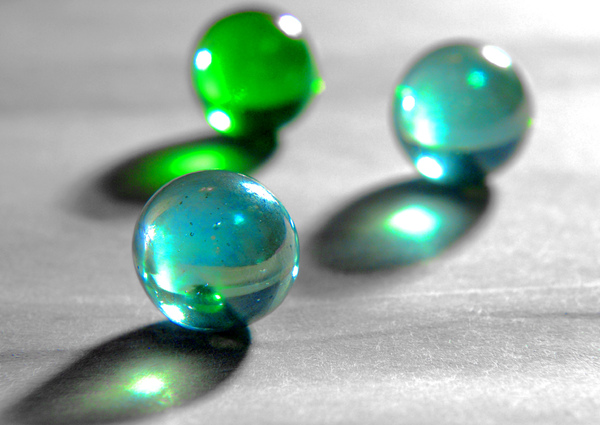 3 Marbles: Close up of three marbles refracting light.