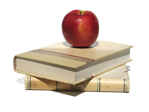 old books and apple: none