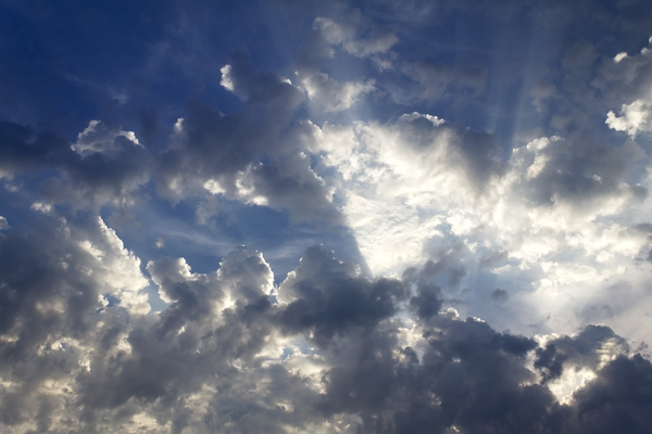 Dramatic sky: Shafts of light from a very early morning sun behind ragged cloud.