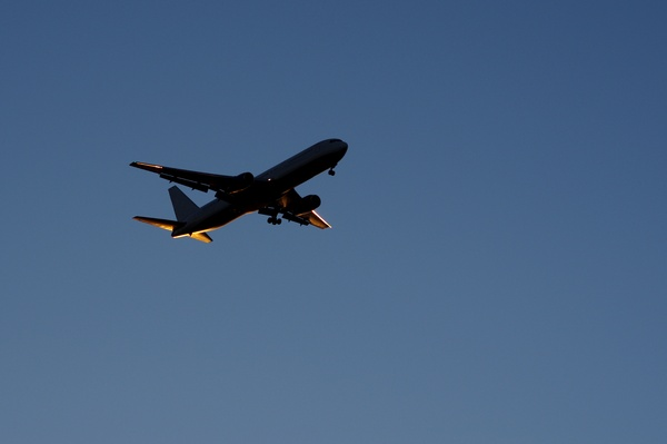 Nightplane: Airplane catching the evening sunlight
