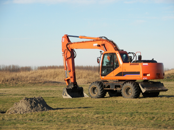 Digging Machine: A digging machine digging some dirt at a military terrain.Please put my real name