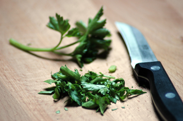 Parsley: Parsley and knive on a cutting board