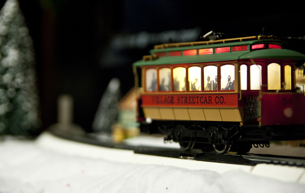 Holiday Street Car: Shallow focus of a holiday train car in a winter village scene.