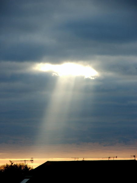 Sun Ray: Sun rays burning through a cloudy sky