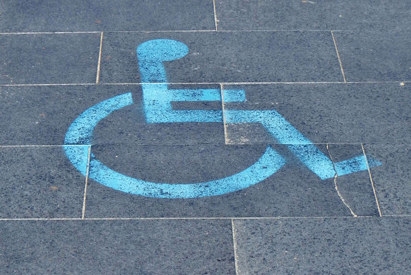 paved disability parking: disability parking symbol on special paved parking area