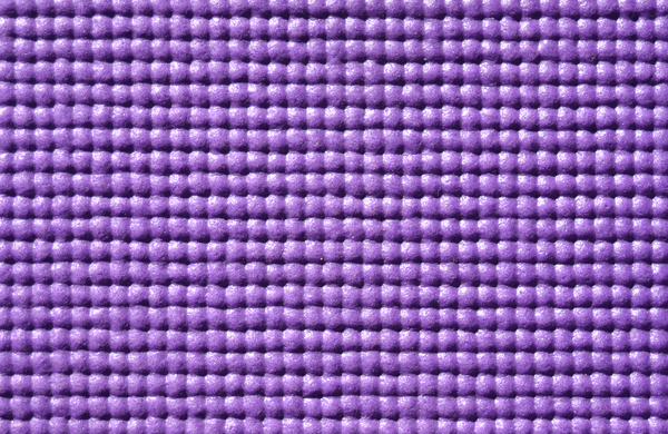 Purple texture: The soft, bumpy texture of a purple yoga mat.