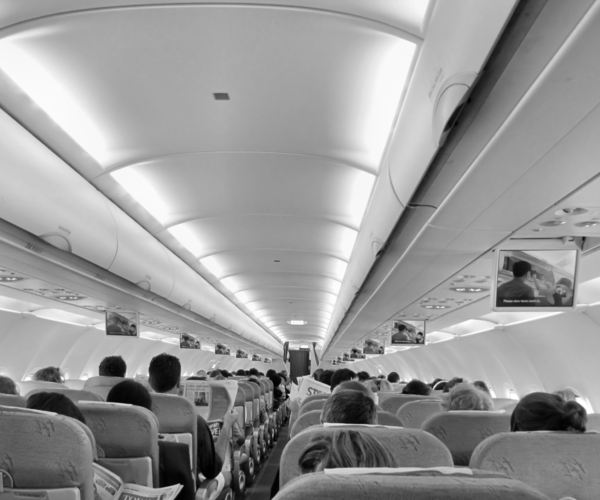 in flight1: passengers on international flight ready for take-off