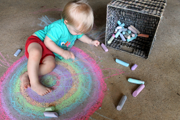 Chalk: Big baby boy making pretty pictures with chalk.