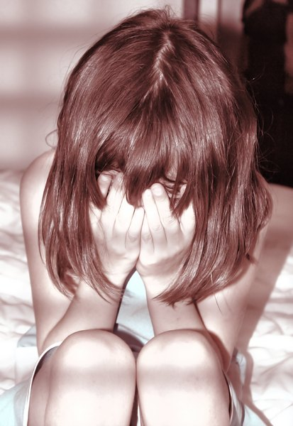 Victim 3: A young girl in tears.