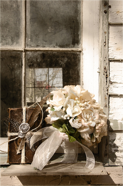 Bouquet and book: Bouquet in the window of an old Southern building