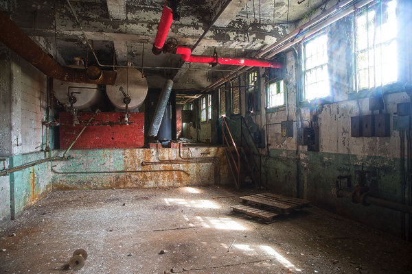 Industrial Decay: This was once an industrial plant room. Now the boilers are silent and the workers gone.