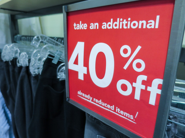 Sale Sign: Sale sign in a store.