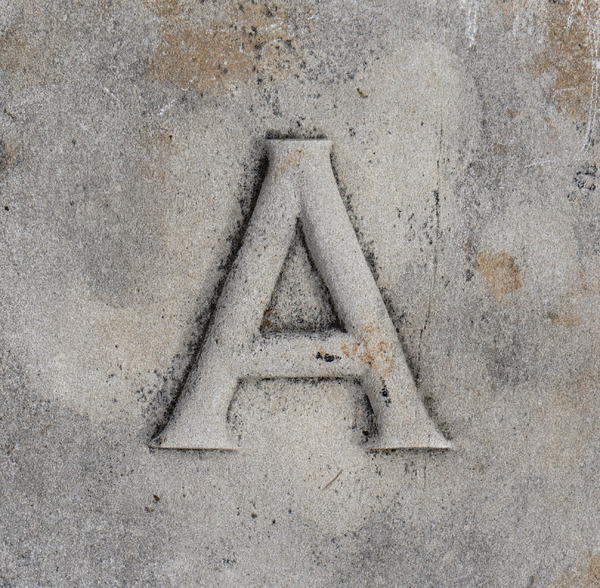 Letter: A letter carved in stone.
