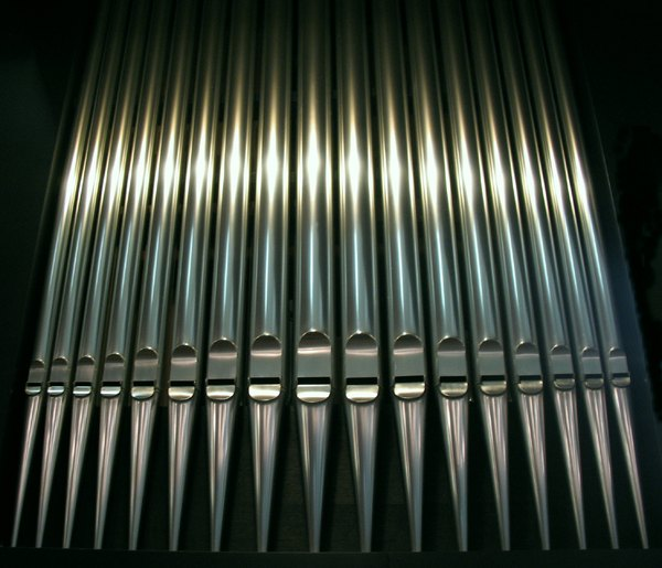 Organ pipes: Pipes of an organ in row/line. High to low and low to high pitch.