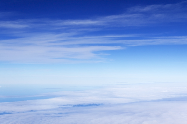 Placid blue sky: A placid blue sky somewhere over Spain.