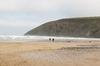 Dogwalkers on a beach
