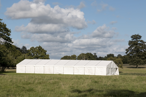 Summer marquee: A marquee in parkland in West Sussex, England.