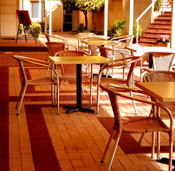 patio dining3: dining tables and chairs on resort patio area
